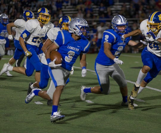 McQueen running back JD Kolb runs for a 71-yard touchdown in the first half against Del Campo at McQueen High School on August 31, 2018.