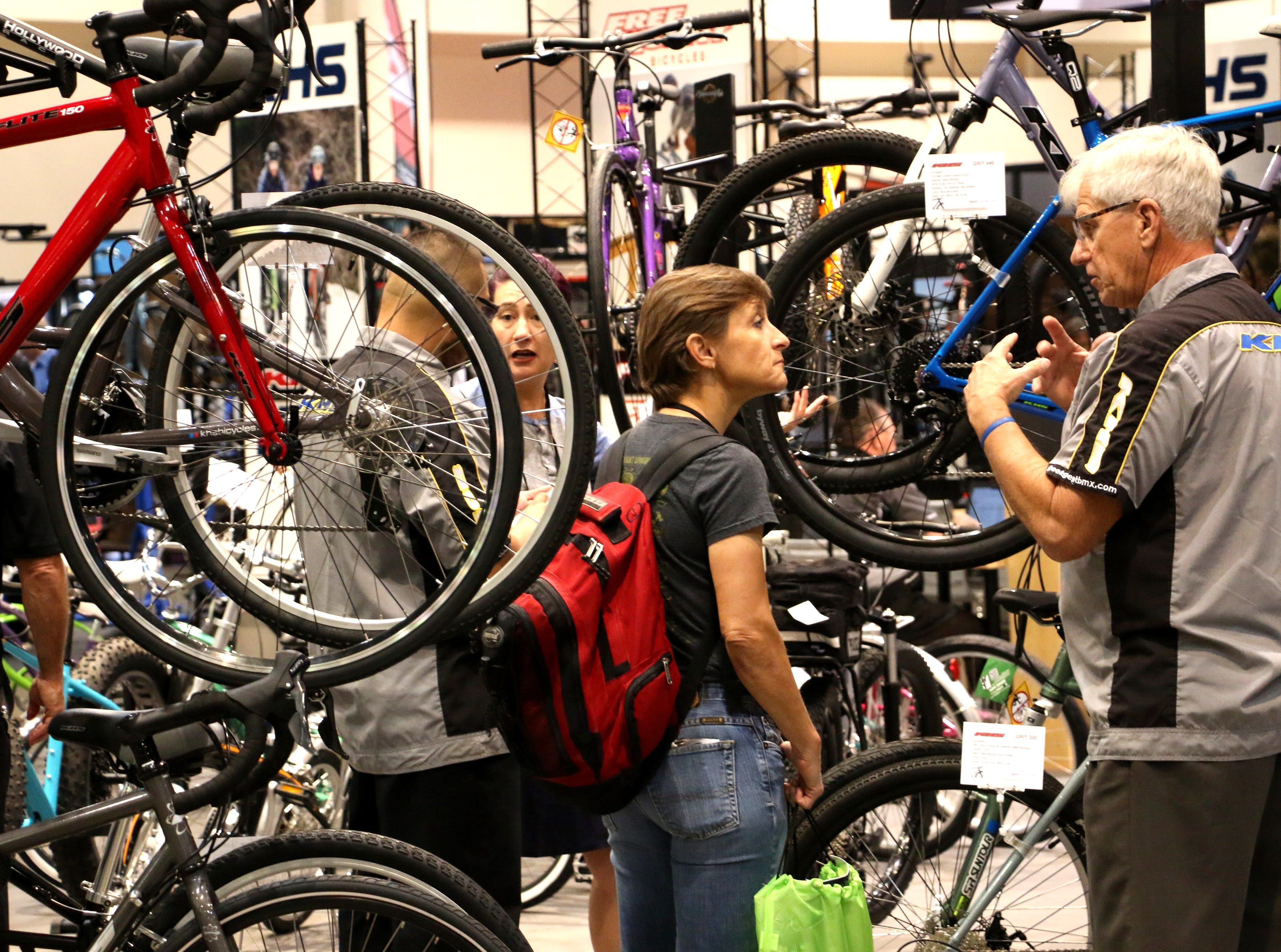 People are seen doing business at the Interbike Expo at the Reno-Sparks Convention Center in Reno on Sept. 19, 2018.