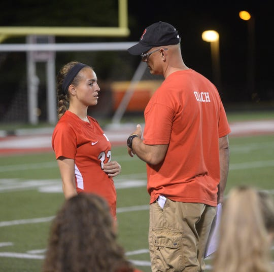 Richmond High School girls soccer player Payton VanMiddlesworth (22) talks to her dad, head coach Neal VanMiddlesworth during a 16-1 win over Anderson Tuesday, Sept. 18, 2018.