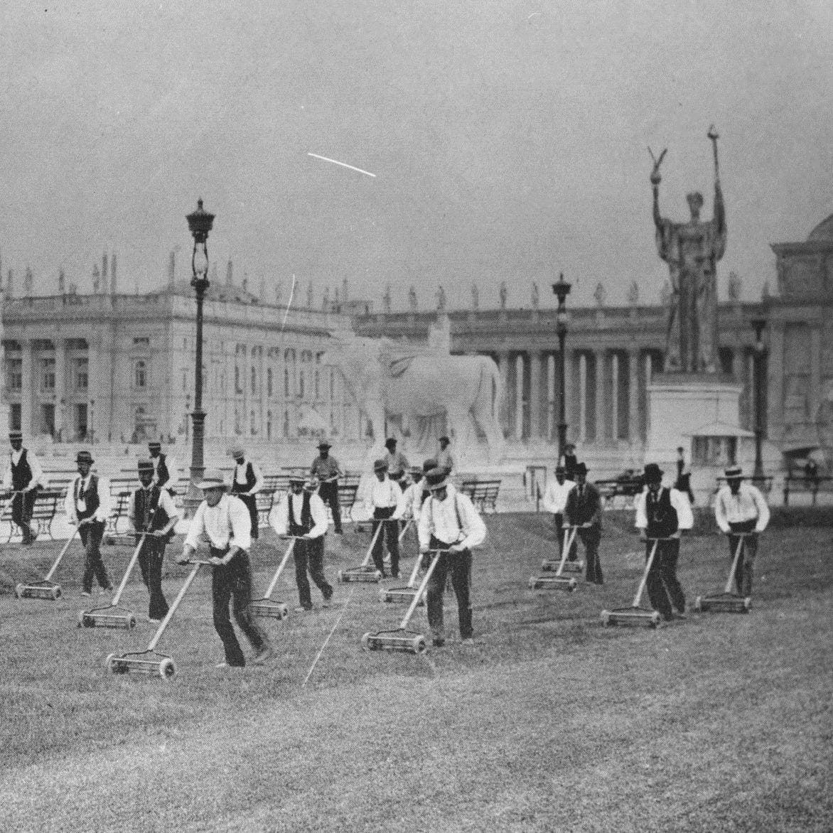 Men give a choreographed demonstration of Elwood McGuire's lawn mower in 1893 during the Columbian Exposition in Chicago.