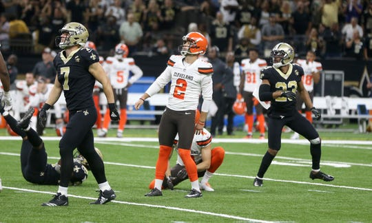 Cleveland Browns kicker Zane Gonzalez (2) watches his 52-yard field goal attempt with New Orleans Saints specialist Taysom Hill (7) and cornerback Marshon Lattimore (23) late in the fourth quarter at Mercedes-Benz Superdome. Gonzales missed the kick. The Saints won 21-18.