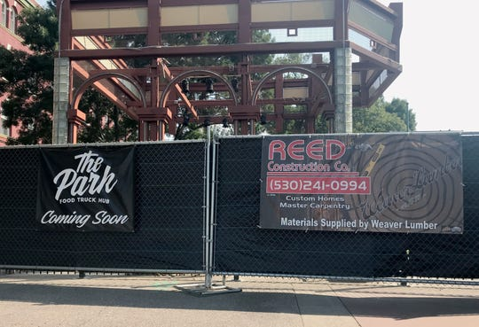 Construction of The Park food truck hub takes place behind fencing in preparation for a Sept. 27 grand opening at Carnegie Park in downtown Redding.
