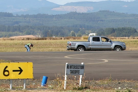 Members of FAA go over the scene where a plane crash took place at Independence State Airport on Wednesday, Sep. 19, 2018.