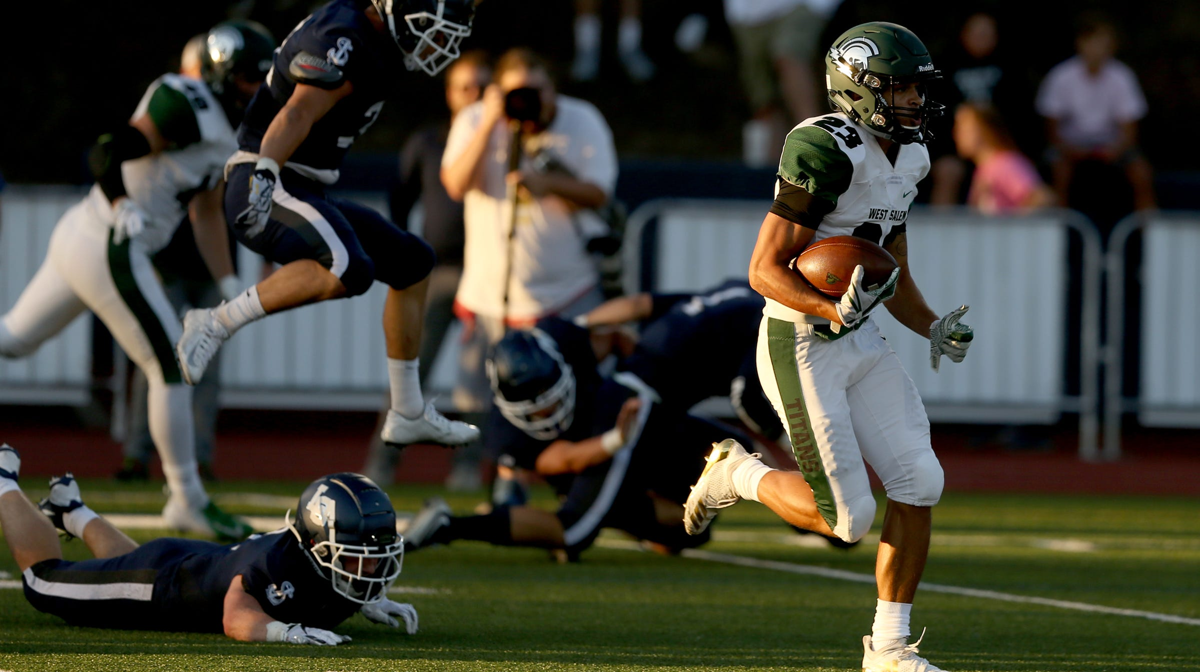 West Salem's Anthony Gould (23) rushes in the first half of the West Salem vs. Lake Oswego football game at Lake Oswego High School on Friday, Aug. 31, 2018.