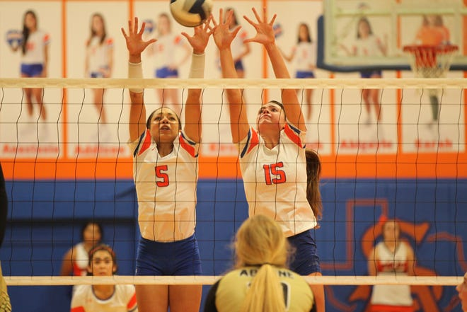 San Angelo Central High School's Mya Moore (5) and Trinity Southall go up for a block during a District 3-6A volleyball match against Abilene High on Tuesday, Sept. 18, 2018. The Lady Cats swept the match 25-13, 25-17, 25-20.