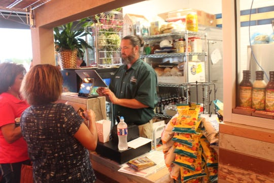 Chef Jason Helfer taking orders from customers at PV Deli, 2561 Sunset Drive.