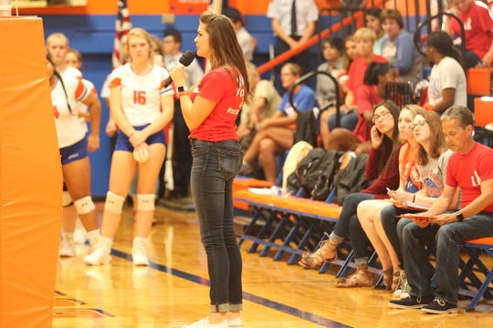 San Angelo Central High School teacher Julie Schniers addresses the crowd before the Lady Cats' District 3-6A volleyball match against Abilene High at Babe Didrikson Gym on Tuesday, Sept. 18, 2018. A silent auction was held for former Central student Zachary Sutterfield, who was severely burned in a fire this summer in San Marcos.