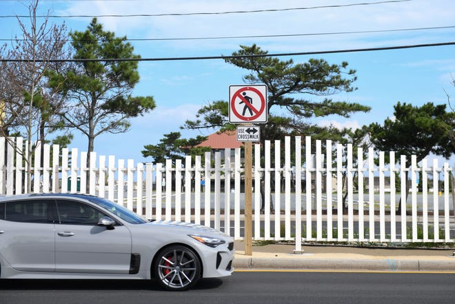 A 2.7-mile long median fence cuts through Coastal Highway between the Route 90 bridge and Convention Center Drive. The fence was installed to keep pedestrians from jay walking and to encourage them to use the crosswalks.