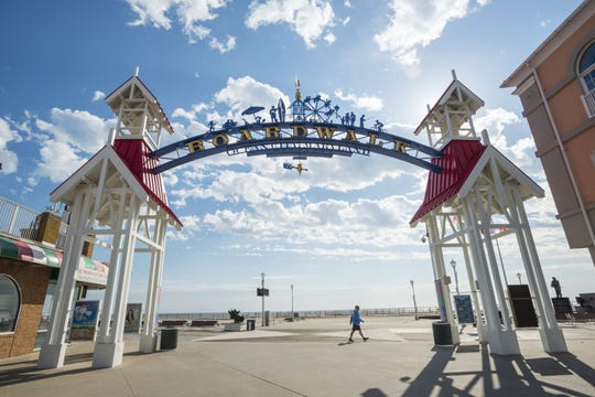 A walker makes his way past the Ocean City Boardwalk arch near North Division Street.