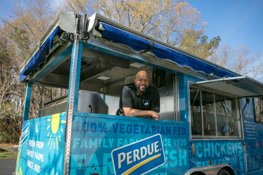 Chef Jonathan Coombs poses in the Perdue food truck which will be in North Carolina this weekend to help with hurricane relief.
