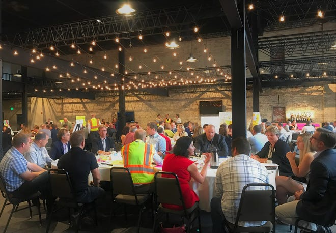 Business leaders, city officials, educators, students and others gather for Sheboygan county's FreshTech Innovation District Summit on Wednesday, Sept. 19 in Sheboygan, Wis.