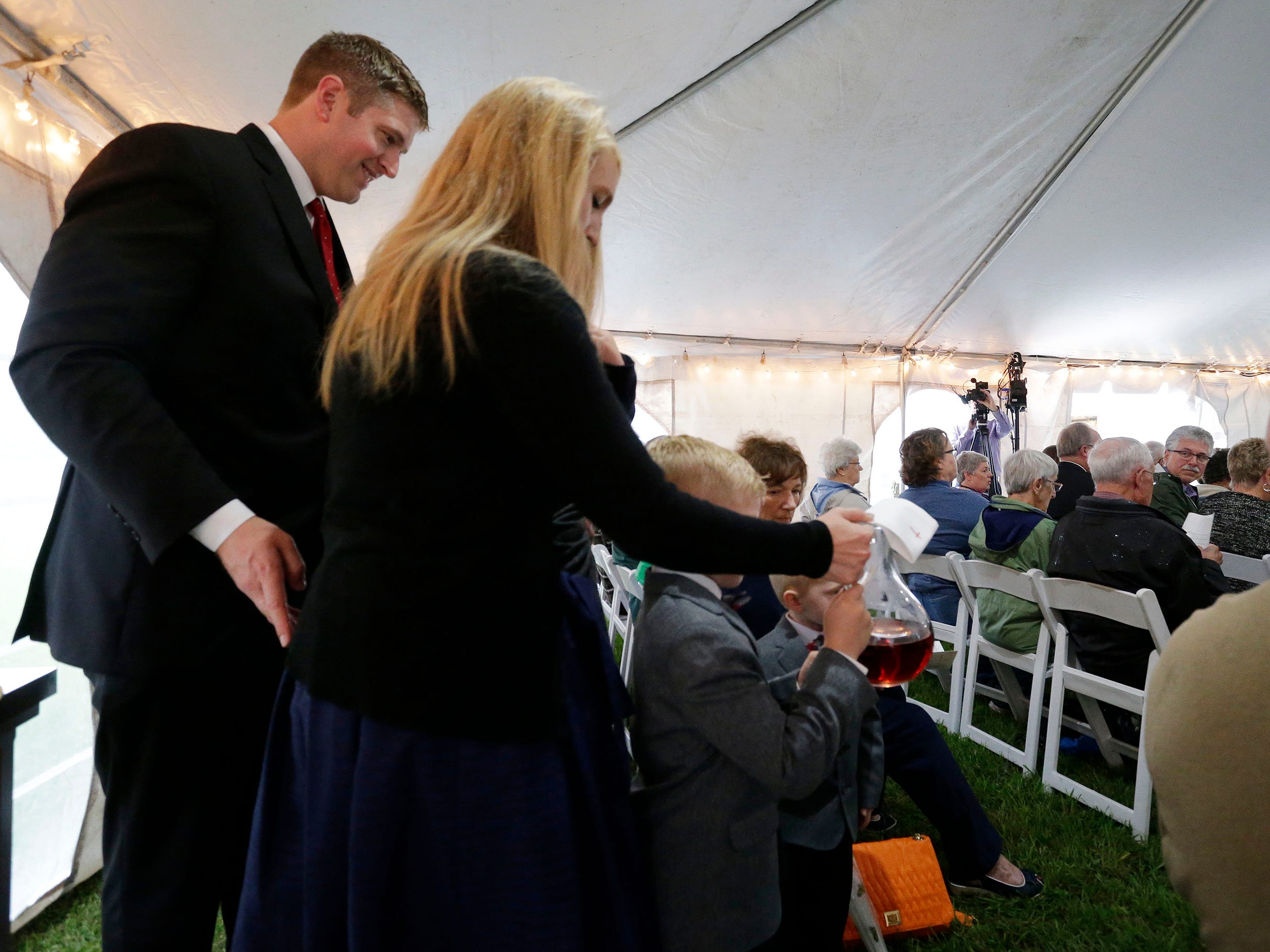 HSHS St. Nicholas Hospital CEO Justin Selle helps his family carry the sacrements during a Mass of Celebration for him at the hospital complex, Wednesday, September 19, 2018, in Sheboygan, Wis.