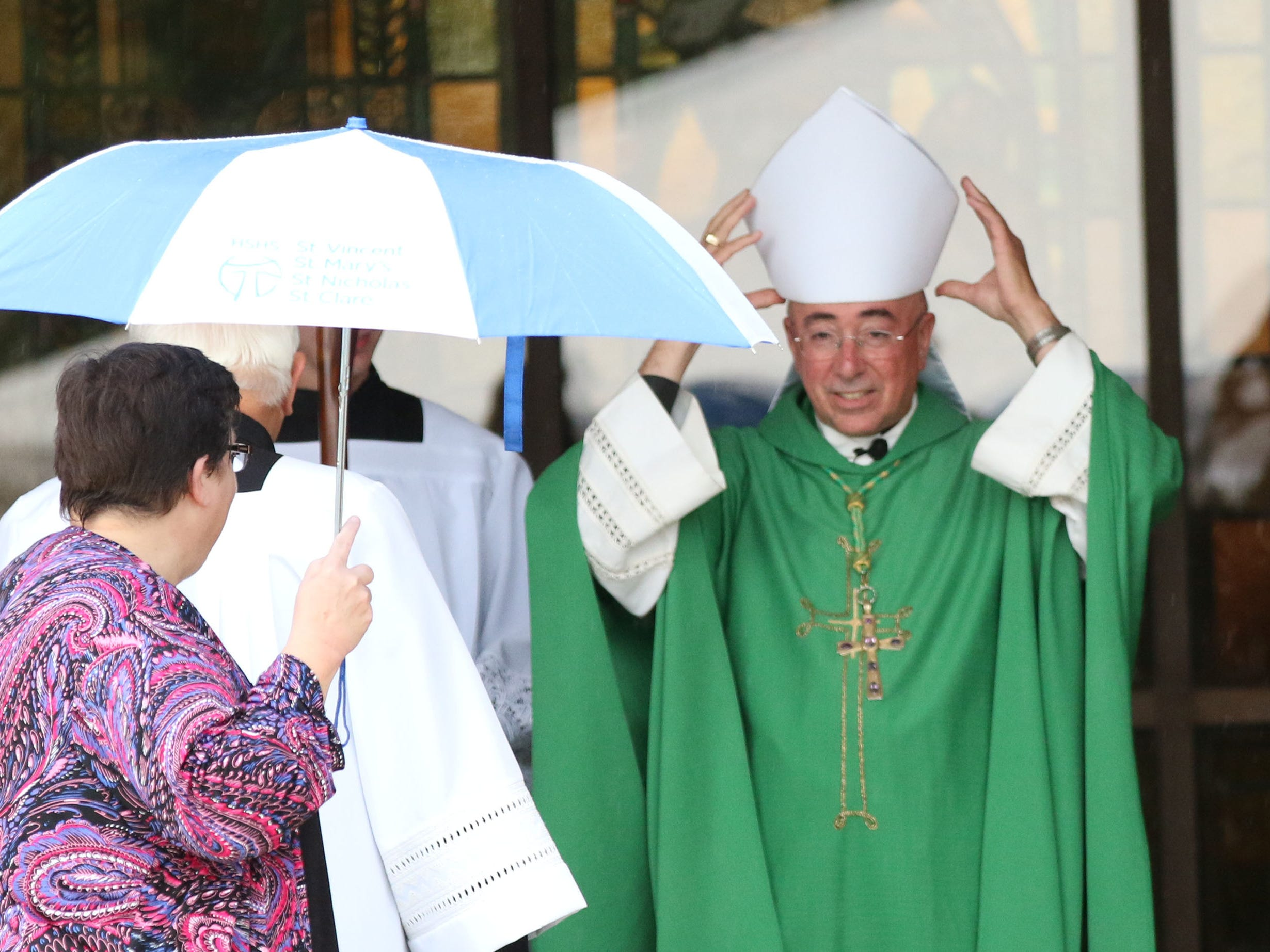 Most Reverend James Schuerman of the Milwaukee Diocese adjust his mitre before a Mass of Celebration for incoming HSHS St. Nicholas Hospital CEO Justin Selle, Wednesday, September 19, 2018, in Sheboygan, Wis.