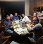From left to right, Mark Zyons, Billy Lewis, Don Dougherty, Martin Courtois, Chris Mazziotti and Derek Sanders enjoy a meal at Dougherty's house in 2018.