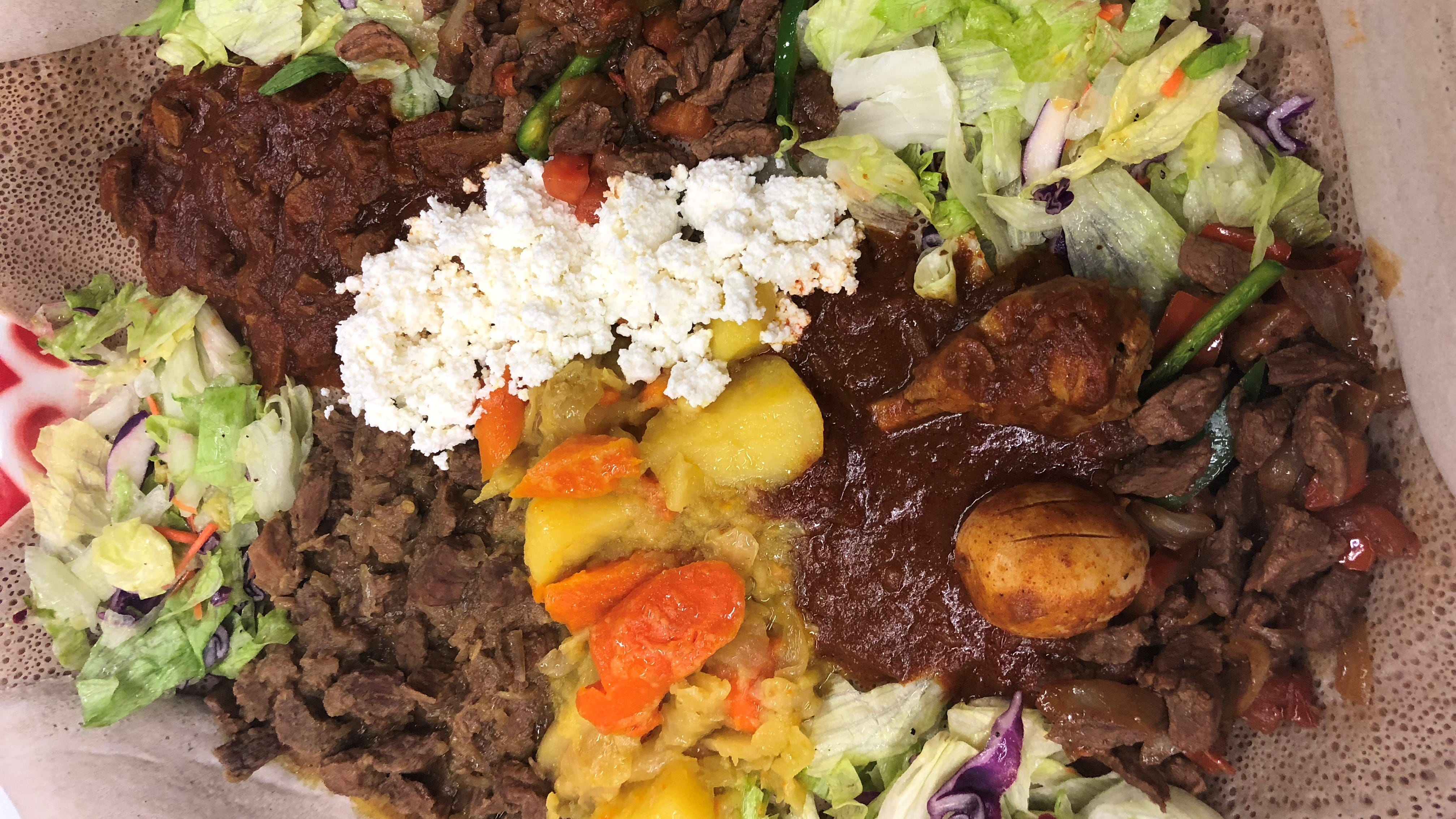 A whole dinner party on one big platter at Lalibela.