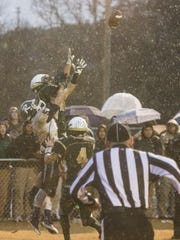 Wilson Memorial's Hunter Carr leaps in the air to intercept a pass thrown by Richland's quarterback during their first round of overtime during the Group 2A state semifinals football game in Fishersville on Saturday, Dec. 6, 2014.