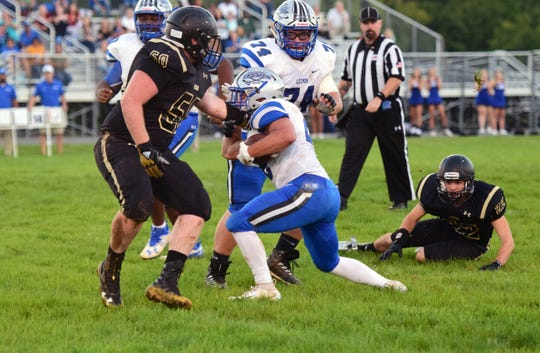Robert E. Lee's Garrett Lawler, center, is stopped by Buffalo Gap's Walker Hostetter during their Shenandoah District football game on Tuesday, Sept. 18, 2018, at Buffalo Gap High School in Swoope, Va.