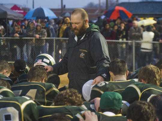 Wilson Memorial's head coach Jeremiah Major says a prayer with his players following their victory over Richlands to advance to the Group 2A state finals football game on Saturday, Dec. 6, 2014 in Fishersville.