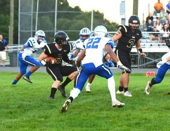 Buffalo Gap's Carter Rivenburg picks hios way through the Robert E. Lee defense during their Shenandoah District football game on Tuesday, Sept. 18, 2018, at Buffalo Gap High School in Swoope, Va.