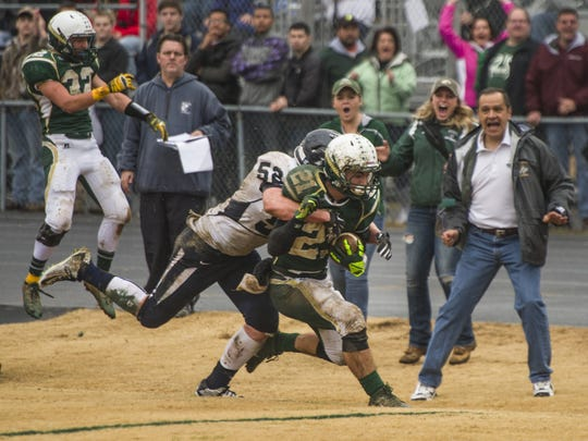 Wilson Memorial's Jesse Trent tries to fight off a tackle by Richlands' Canaan Addison during their Group 2A state semifinals game in Fishersville on Saturday, Dec. 6, 2014.