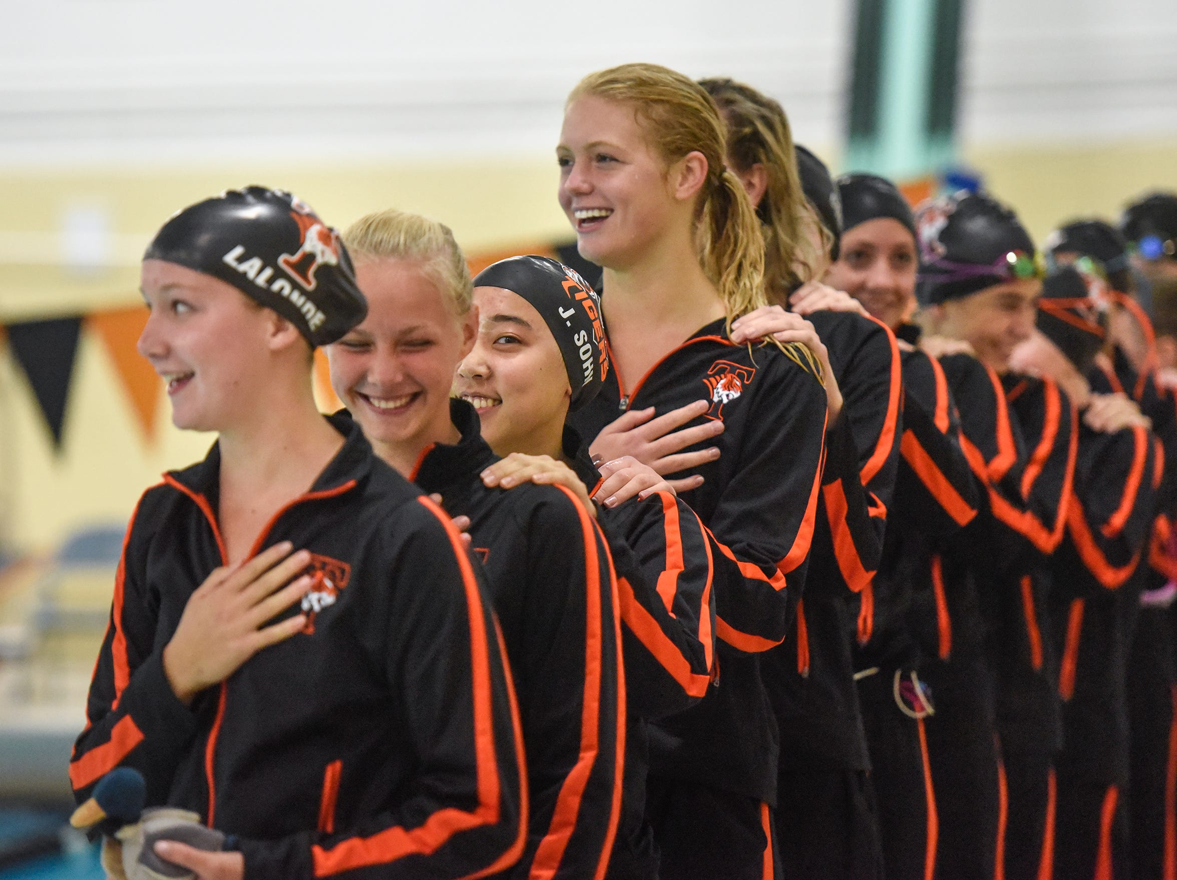 Tech swim team members line up before the start of the National Anthem during the Tuesday, Sept. 18 meet against Buffalo at Tech High School in St. Cloud.