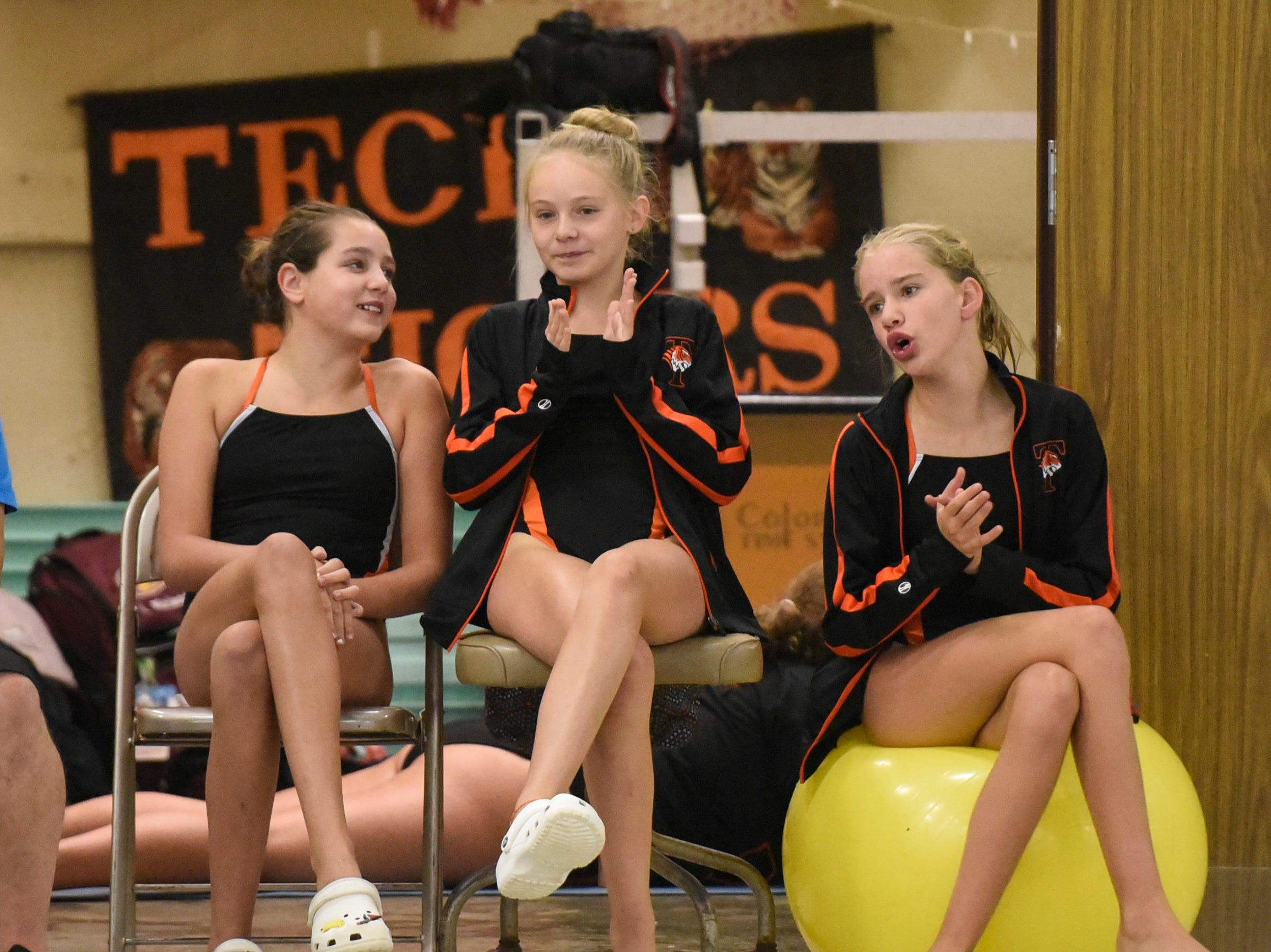 Tech swim team members watch the diving competition during the Tuesday, Sept. 18 meet against Buffalo at Tech High School in St. Cloud.