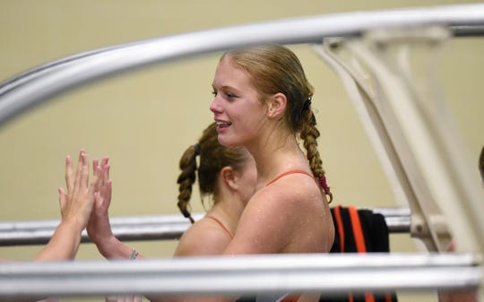 Tech's Meredith Matchinsky is congratulated by teammates during the Tuesday, Sept. 18 meet against Buffalo at Tech High School in St. Cloud.