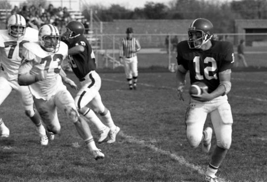 St. Cloud State football player Keith Nord runs with the football in a game against Moorhead State University in  October 1977. Nord played for the Huskies from 1975-79 and then for the Minnesota Vikings for seven seasons.