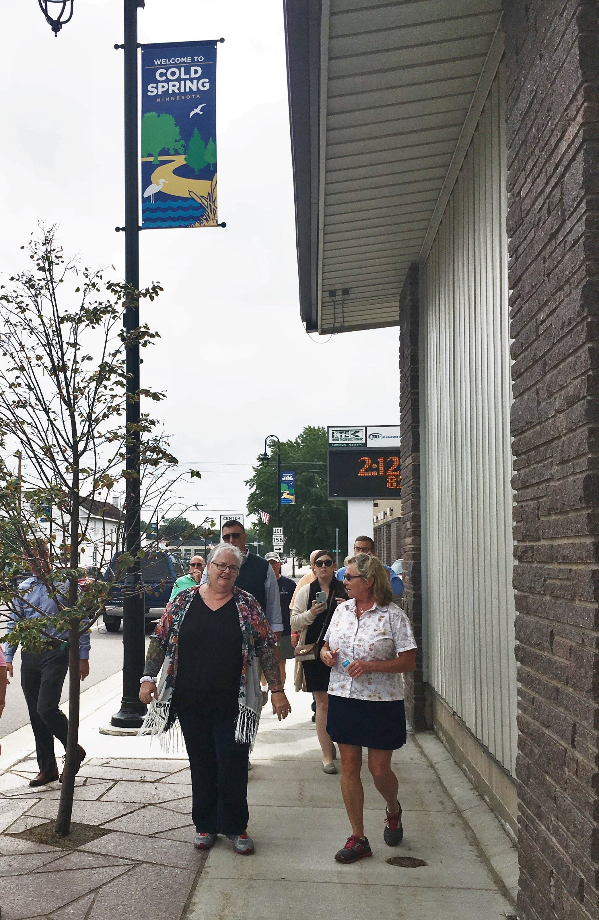 A group toured downtown Cold Spring with Deb Brown, a nationally-known community development specialist, on Friday, Sept. 14, 2018. Brown suggested adding community murals on large blank walls, like the ones at Thrifty White Pharmacy.