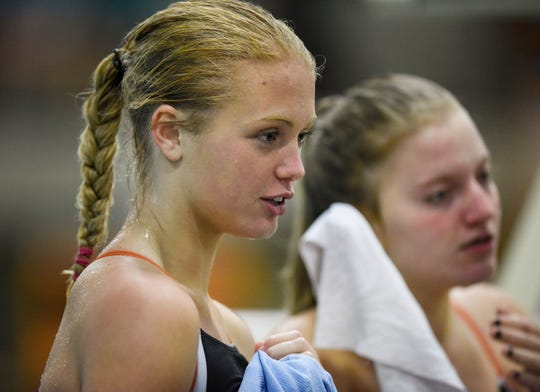 Tech's Meredith Matchinsky talks with teammates before the start of the Tuesday, Sept. 18, 2018 meet against Buffalo at Tech High School in St. Cloud.