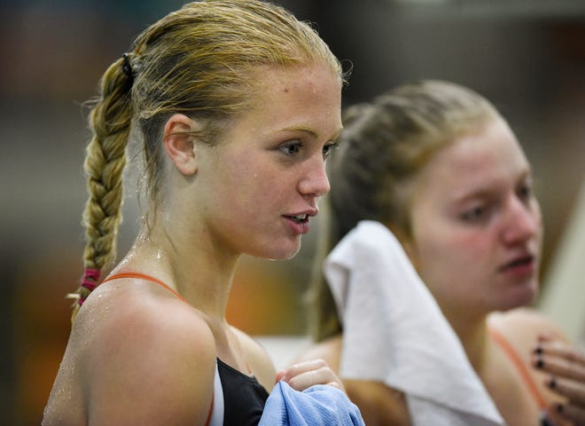Tech's Meredith Matchinsky talks with teammates before the start of  the Tuesday, Sept. 18 meet against Buffalo at Tech High School in St. Cloud.