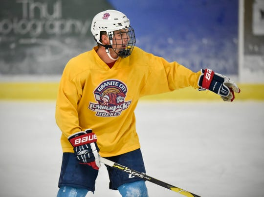 Noah Bissett runs through a drill with teammates during practice Tuesday, Sept. 18, at Sports Arena East in Sauk Rapids.