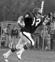 St. Cloud State football player Keith Nord runs with the football in a game against the University of Minnesota-Morris in October 1978 at Selke Field. Nord was inducted into the St. Cloud State Hall of Fame in 1989.