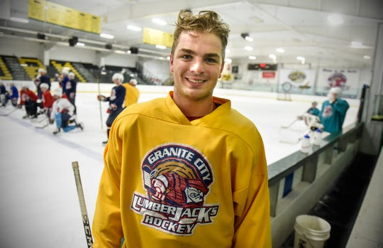 Noah Bissett smiles during a short break in practice Tuesday, Sept. 18, at Sports Arena East in Sauk Rapids.