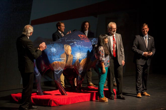 DSU President Richard Williams stands as Wayne Provost, director of innovation, guidance and support, is honored with a decorated bison for his work. Williams gave his annual state of the university address on Wednesday, Sept. 19, 2018, the school's 107th birthday.