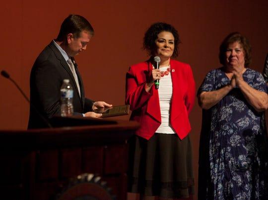 DSU Faculty Senate President Michelle McDermott, center, presents University President Richard Williams with an award at the state of the university address Wednesday, Sept. 19, 2018.