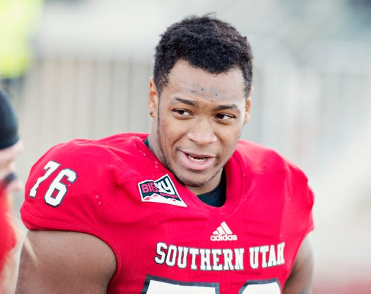 Marquez Tucker smiles during a game in 2017.