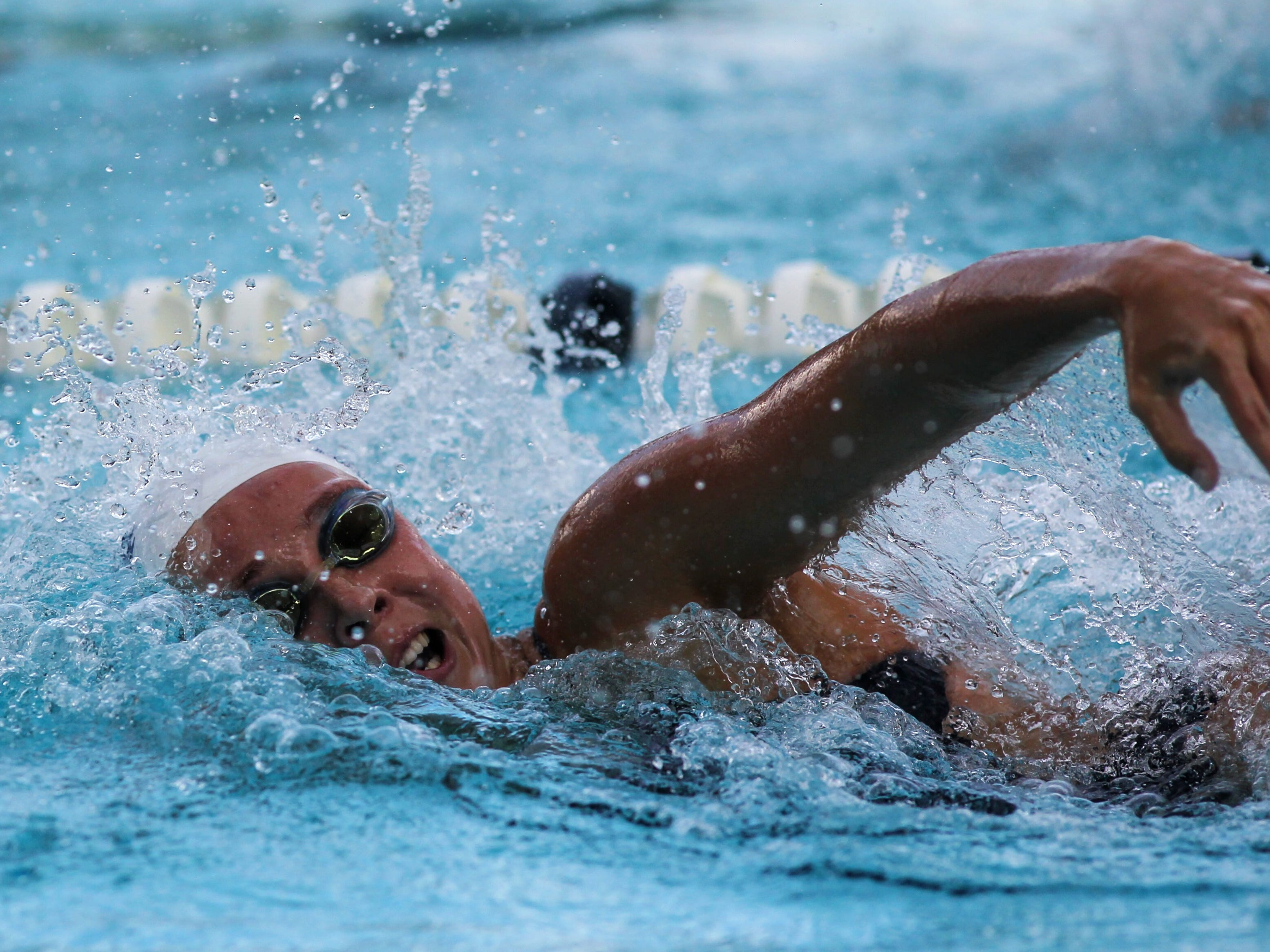 Maclay's Meg Howell swims freestyle during a recent swim meet.