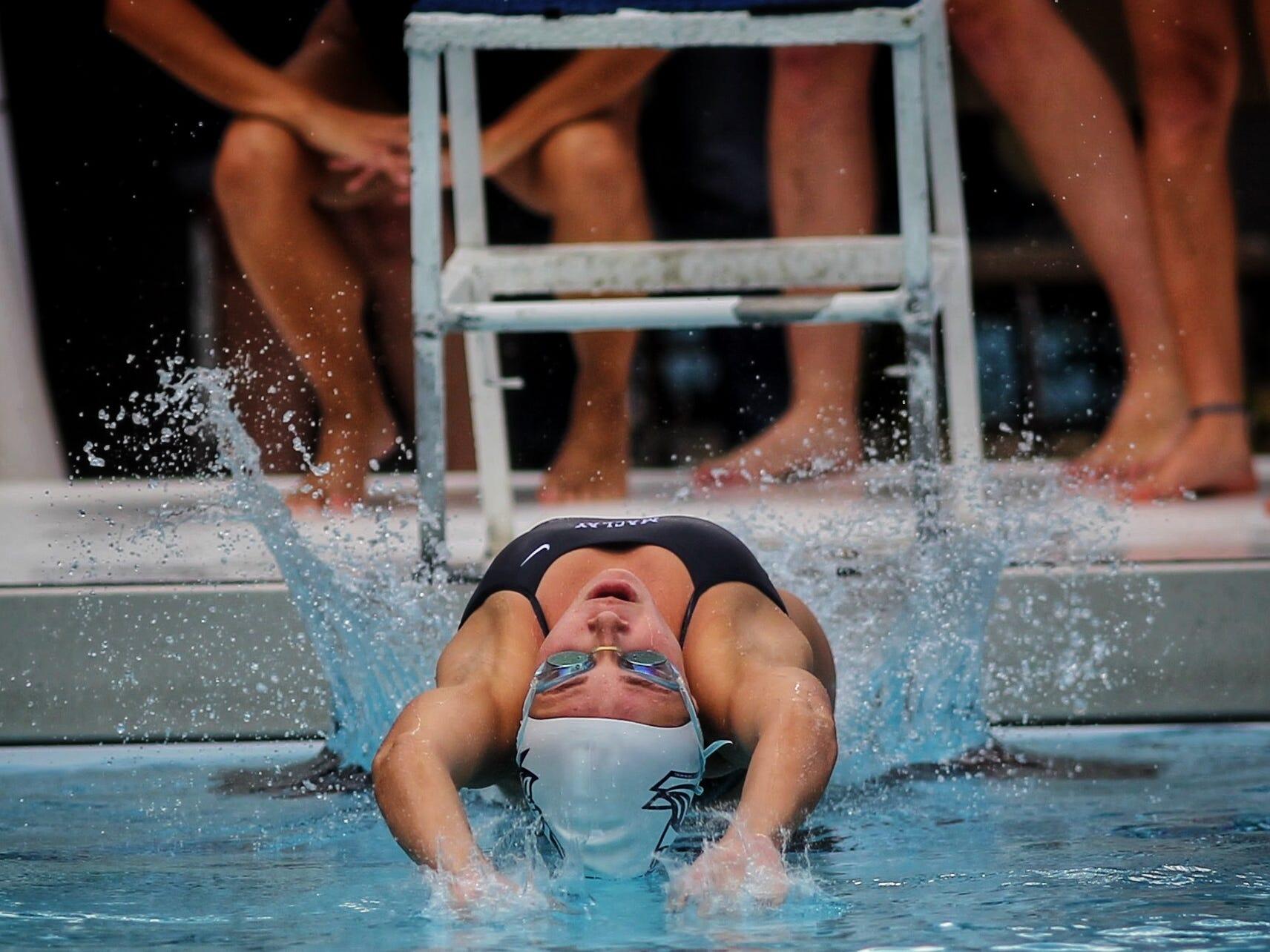 Maclay's Meg Howell starts backstroke during a recent swim meet.