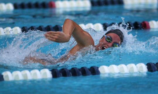 Chiles' Virginia Russell swims to a win in the 50 freestyle during a recent swim meet.