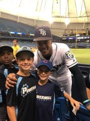 Rays outfielder and Tallahassee product Mallex Smith with Tyson, left, and Devin Stephens at Tropicana Field last Saturday.