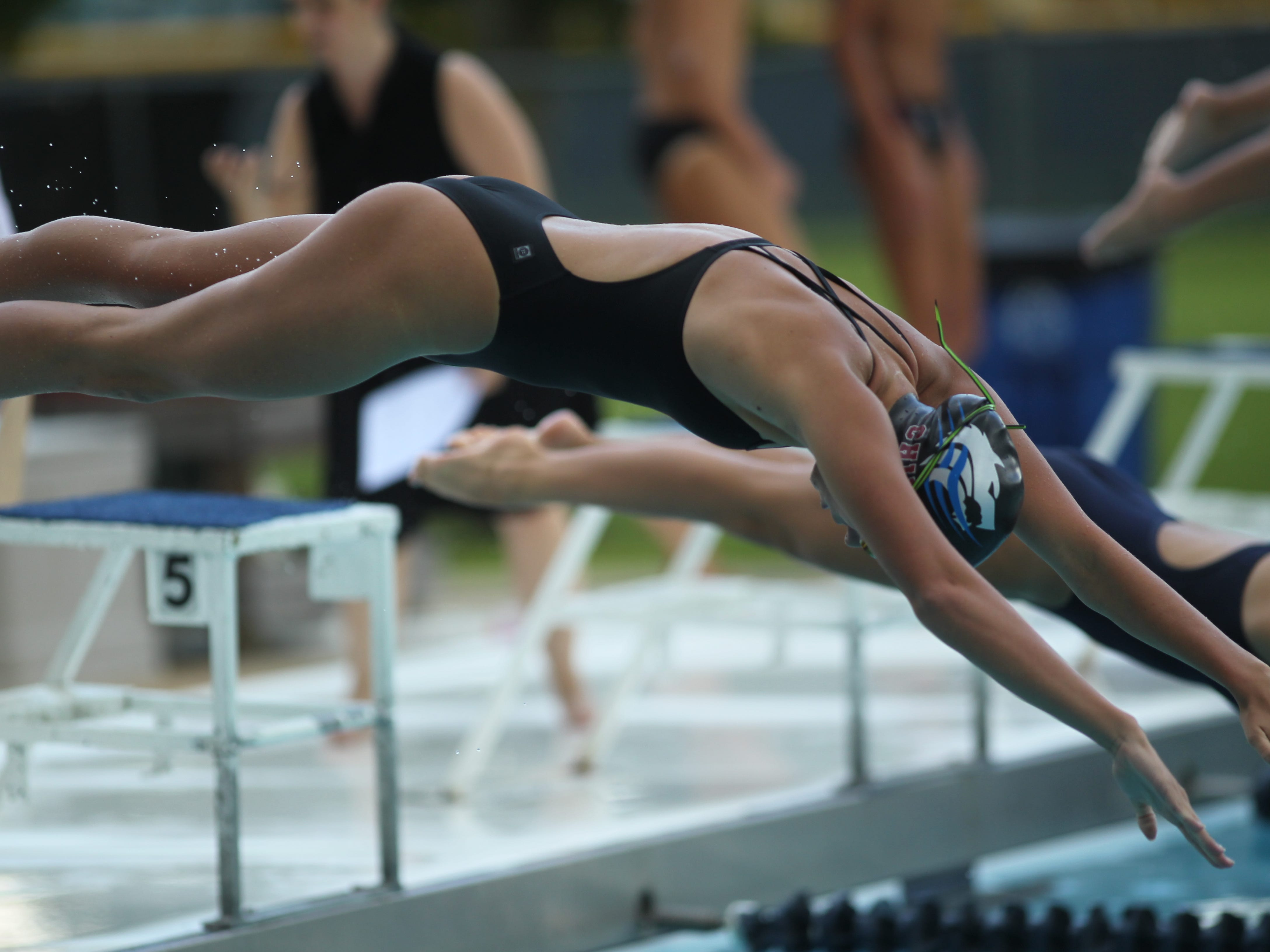 Chiles' Stella Grace Watts dives in the pool for the 200 IM during a recent swim meet.