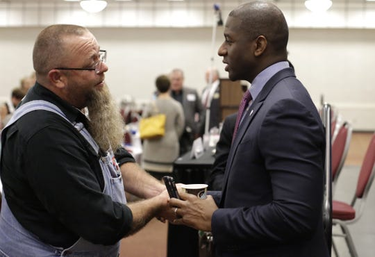 Tallahassee Mayor Andrew Gillum (right) talks to Radio Personality Greg Marr Jr. after speaking at the May 31 meeting of theTiger Bay Club at the Tucker Civic Center.