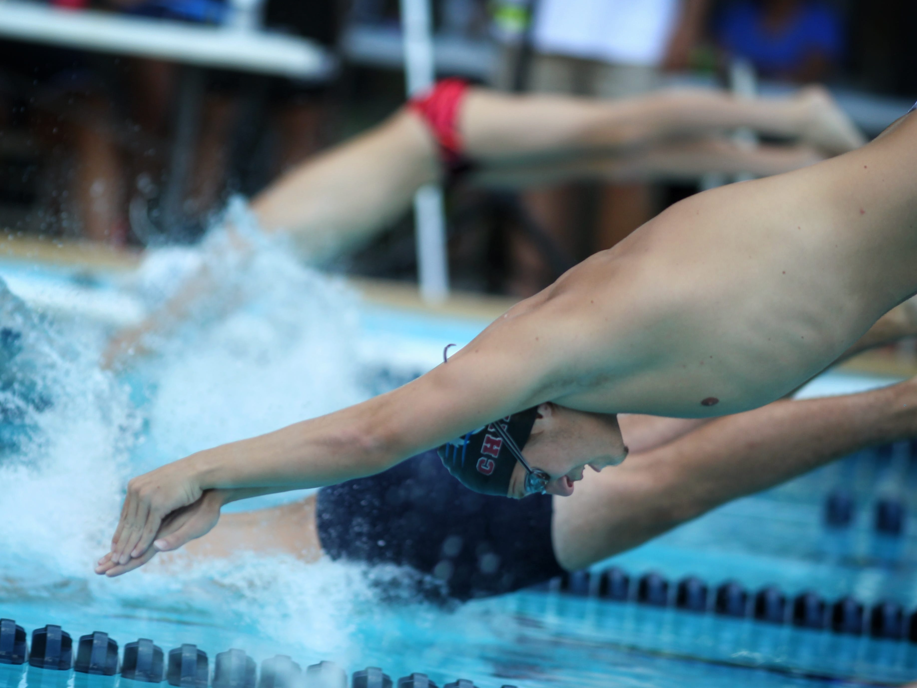 Chiles' Parker Brown dives into the pool for the 50 freestyle during a recent swim meet.