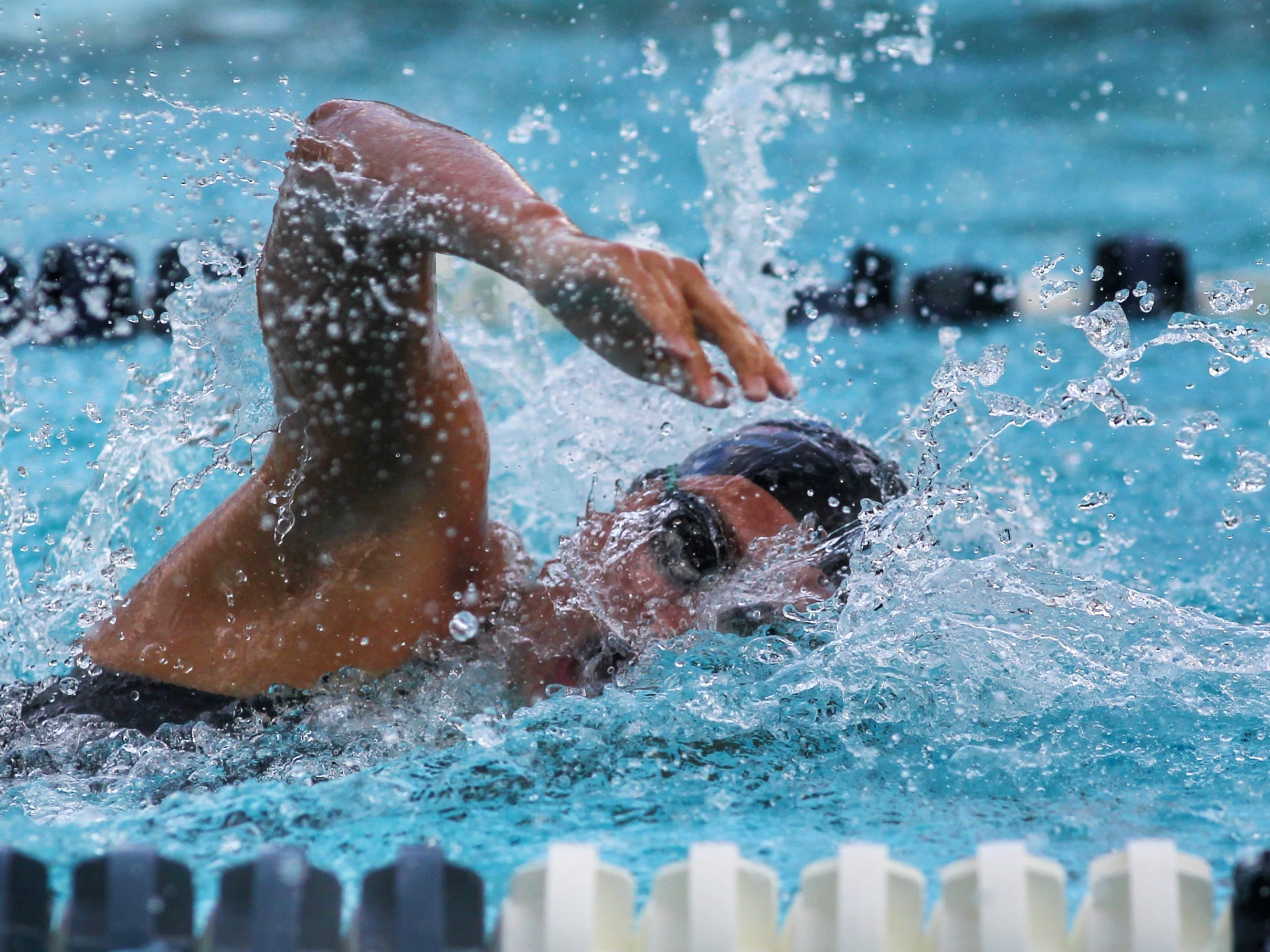 Chiles' Kealyn Bowie swims freestyle during a recent swim meet.