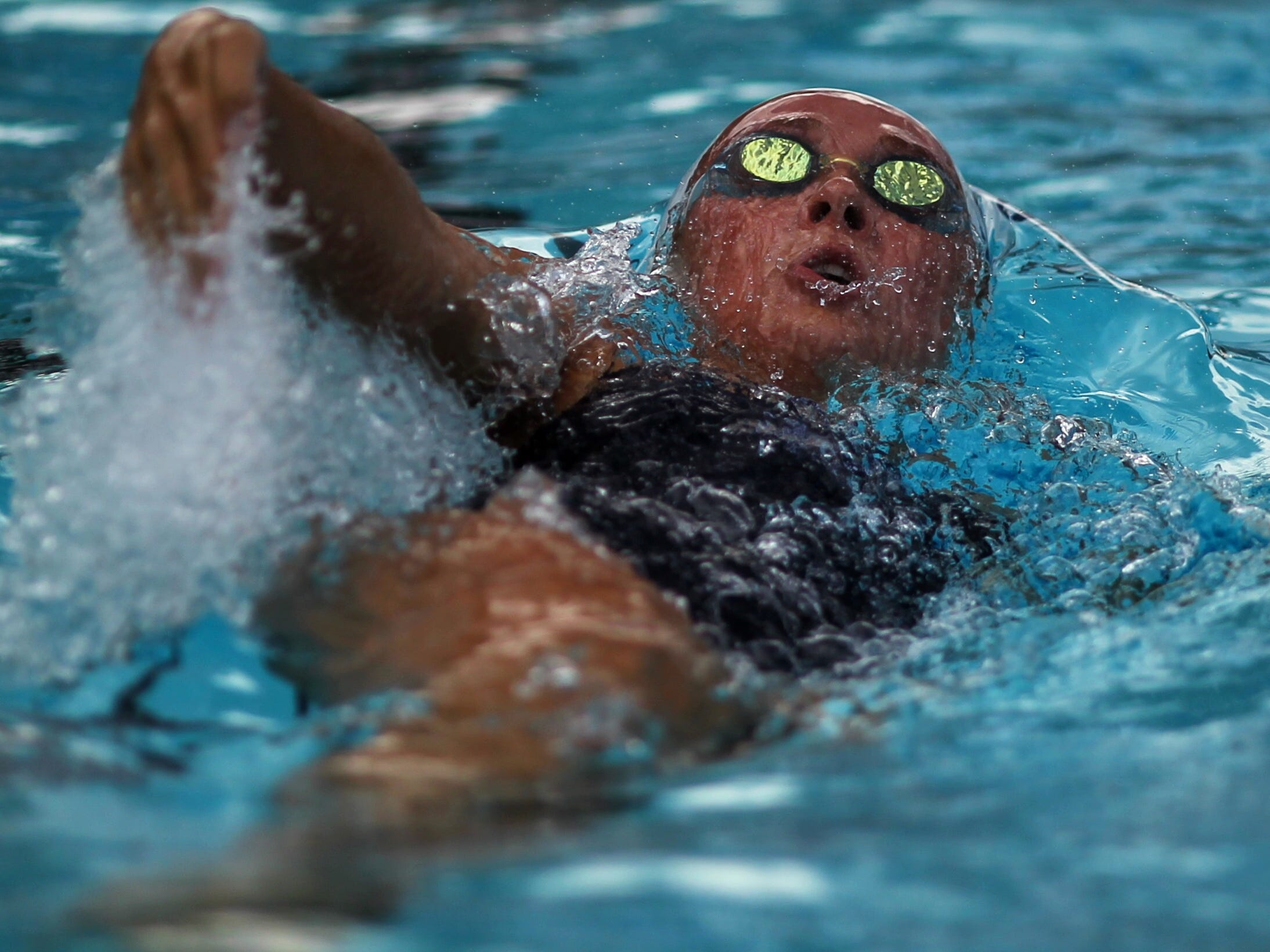 Maclay's Meg Howell backstrokes during a recent swim meet.