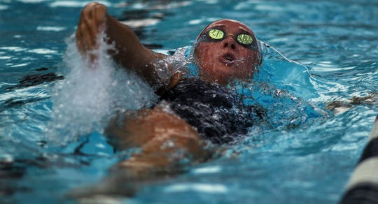 Maclay's Meg Howell backstrokes during a recent swim meet.