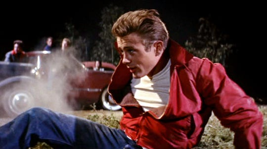 """Movie icon James Dean breaks out the red jacket and forms his own family with Sal Mineo and Natalie Wood in the classic """"Rebel Without A Cause"""" (1955)."""