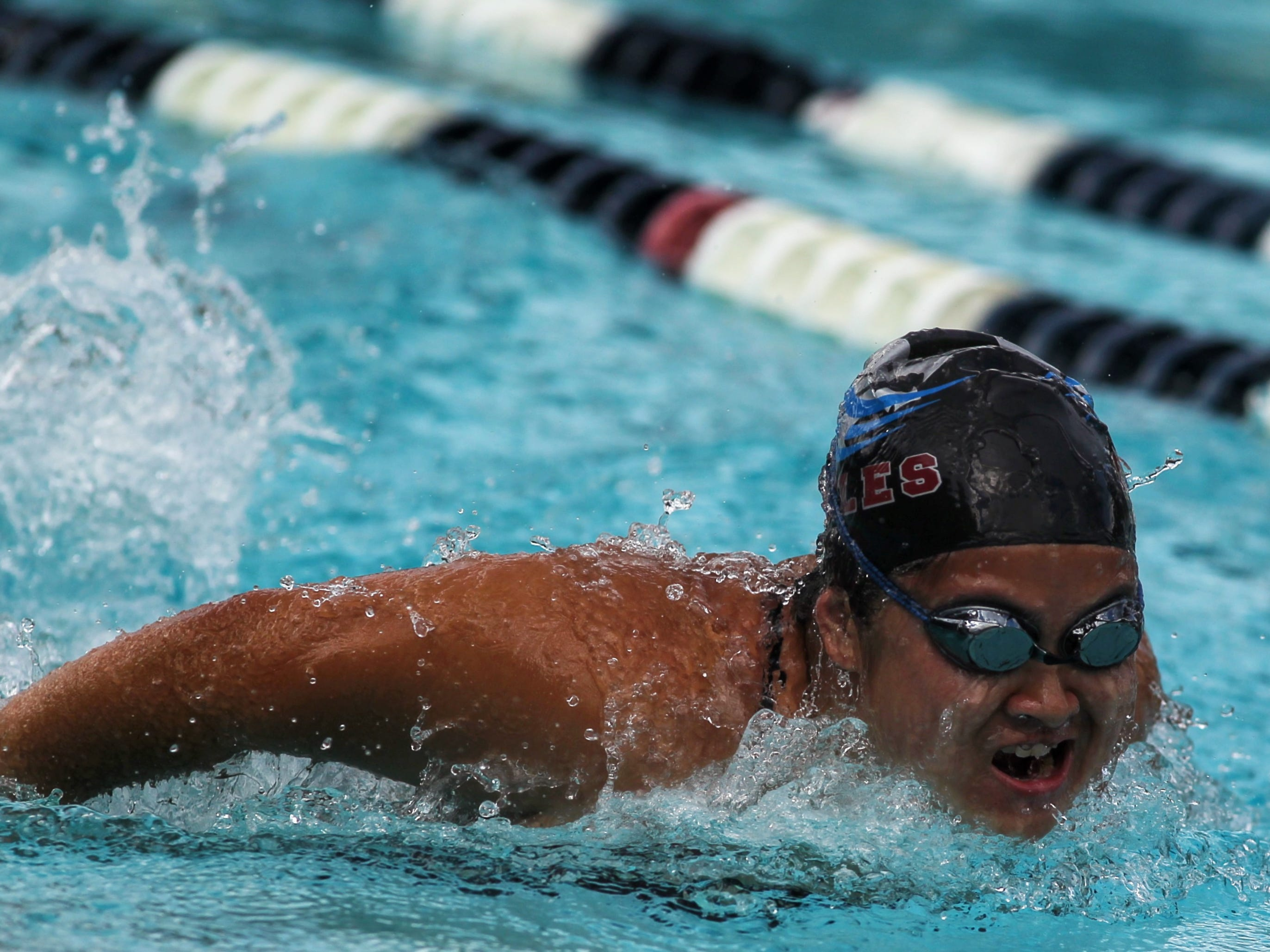 Chiles' Cattie Li swims butterfly during a recent swim meet.