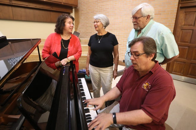 Roberta Daniel, Taize prayer services cantor, Anita Parrish, Taize prayer services coordinator, Neal Evans, sound technician and Bret Whistle, cantor, sing together around the piano during a practice run for future Taize prayer services at Faith Presbyterian Church on North Meridian Road in Tallahassee, Fla. Tuesday, Sept. 18, 2018.